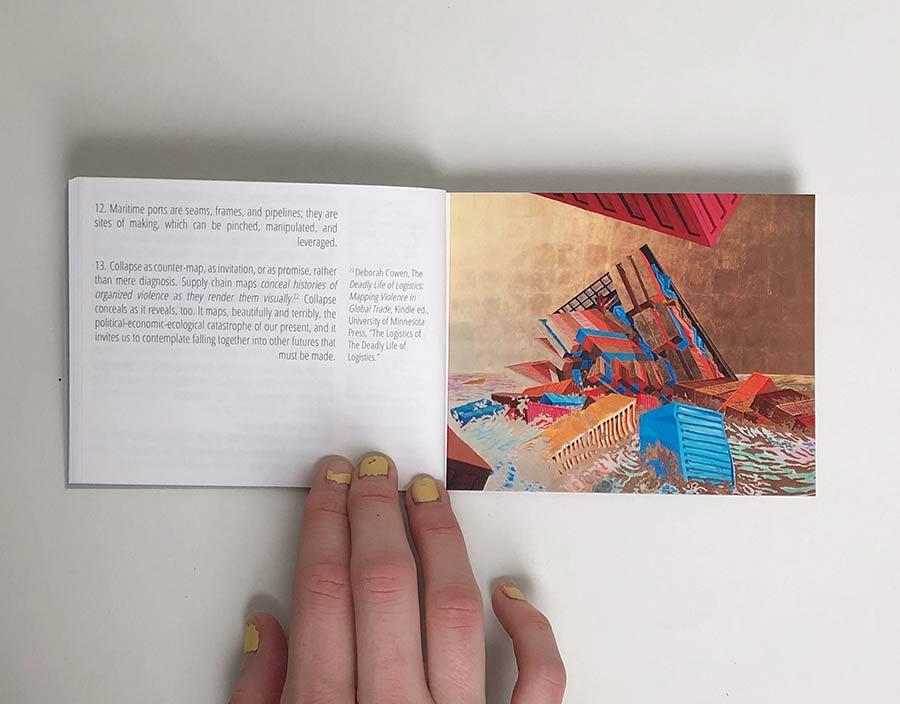 a hand holds open a spread from a booklet. The left side has illegible text and the right spread is a painting of a container ship